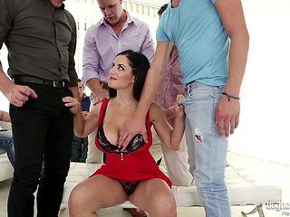 hot brunette entertains gang of men @ bukkake bang