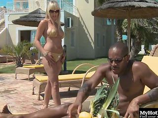 Curvaceous Nataly D'Angelo rides the black pecker next to the pool