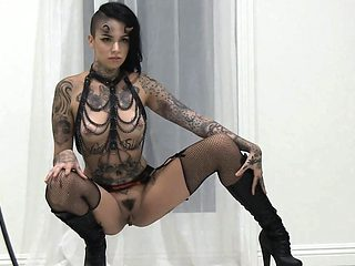 Goth beauty spreads her pussy for photoshoot