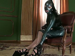 The lusty Latex Lucy returns  in a deliberately frightening black outfit that makes her look like...