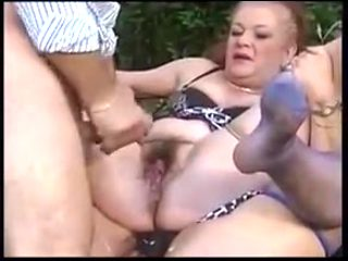 2 matures Fuck An mate On A Bed In The Yard
