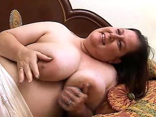 BBW in bed plays with her massive natural tits