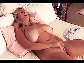 beautiful busty pierced blonde masturbate on bed