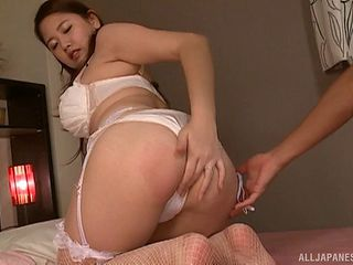 Sexy Asian babe rubs her clit before riding a massive rod