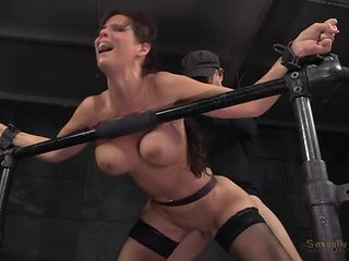 Milf in the dungeon used as a sexy slave