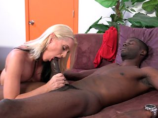 Impressive mom spins the black cock like a real goddess