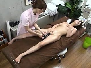 Slender Asian girl lies on the massage table and is made to