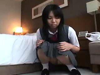 Delightful Japanese schoolgirl in white panties flashes her