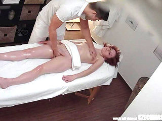 Dilettante Czech redhead acquires her twat fingered during oil massage spycam menacing-menacing P...