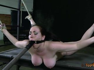 Big tits chick bound by rope and loving the suffering