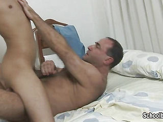 The older lover got down on the bed and pressed the sleeping boy against his hairy body.