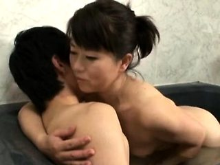 Captivating asian mature gets her tits and slit played with