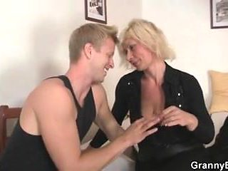 Old blonde takes cock from behind