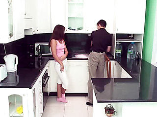 The guy with the maid standing in the kitchen talking