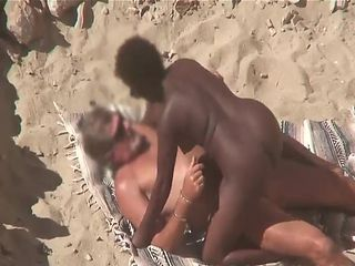 Interracial couple caught fucking on the beach