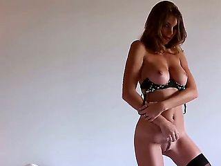 Mesmerizing and astonishing Amber Sym poses, strips and teases in front of the camera demonstrati...