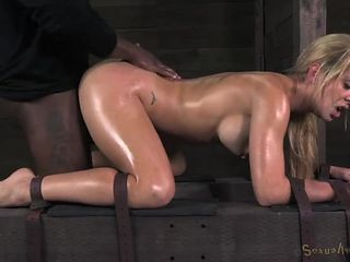 Oiled and bound blonde fucked from both ends