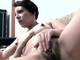 MILF masturbating with 2 Dildos