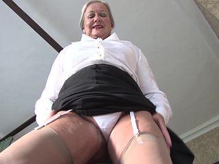 Beautiful matured granny in nylon stockings stripteasing seductively indoors