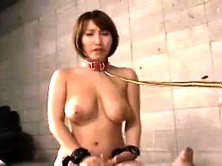 Submissive Asian slut with big natural tits deepthroats a s