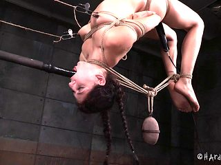 Pushing the toy into mouth of a tied up babe Nikki Knightly