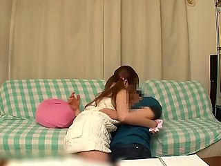 A sweet Asian girl sits near her classmate in the library. She cant think about him lessons, beca...