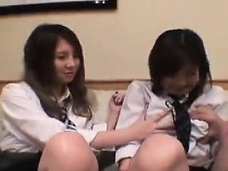 Two naughty Asian schoolgirls open their blouses to play wi