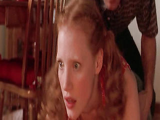 Jessica Chastain naked in a kitchen with the guy as he makes out with her and lifts her up to pla...