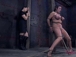Busty raven-haired filly gets tied up by her smoking hot domina