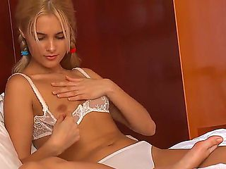 Skinny blonde Sasha is having a great time masturbating her tight little shaved cunt