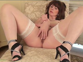 Mommy in hot stockings rubs her pussy solo
