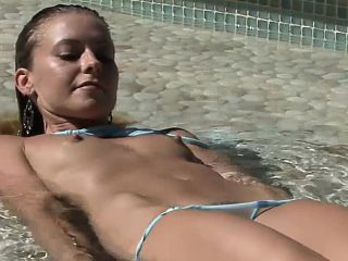 Glamour pussy on the beach is sunbathing