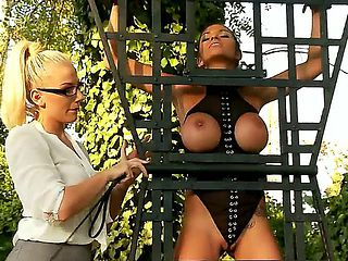 Gorgeous golden haired and sexy dominatrix Danielle Maye in her shirt and tight skirt gets a whip...