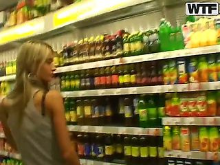 Slim blonde chick Nessa Devil strolls trhough a store while her lover is recording her lovely tit...