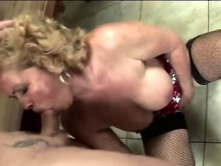 Horny granny gets fucked on a kitchen table