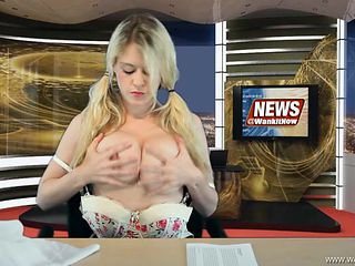 Babe reading the news and stripping erotically