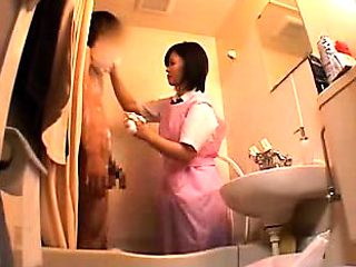 Enchanting Japanese maid wraps her skillful hands around a