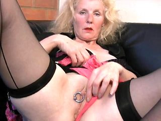 Huge ring through her pierced mature pussy lips