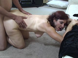 Saggy mature titties bouncing around as the lady rides cock