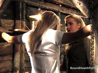 Lesbian Huntress Inspecting Tied Up Slave