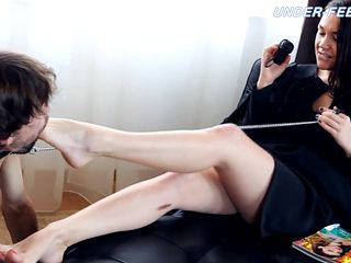Intimate Russian babe reading magazine while her toes are licked in femdom porn