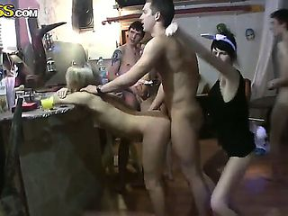 A fun group of teenagers celebrates something and get drunk. Slutty virgin girls undress fast and...