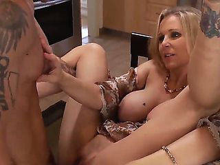 Tattooed and handsome guy Alan Stafford making his girlfriends mom Julia Ann happy at the kitchen