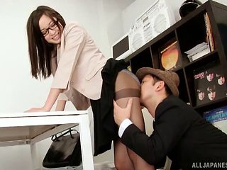 Japanese brunette with glasses and long hair giving a handjob