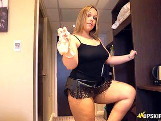 Fat ass British hottie models miniskirts in a hotel room