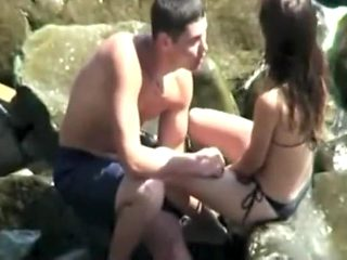 Sneaking to a couple fucking on the rocks