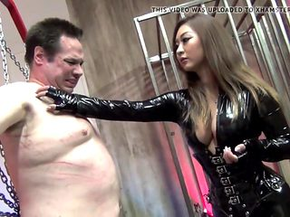 Dominatrix scratching slave