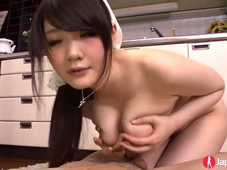 Busty naked Japanese girl blows him in the kitchen
