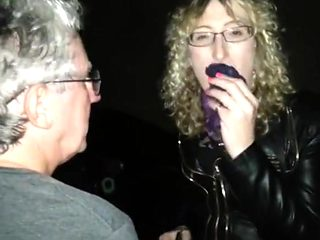 Lisa being pissed on in the car park outdoors.