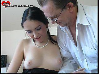 Shaved pussy brunette in thong loves licking huge balls